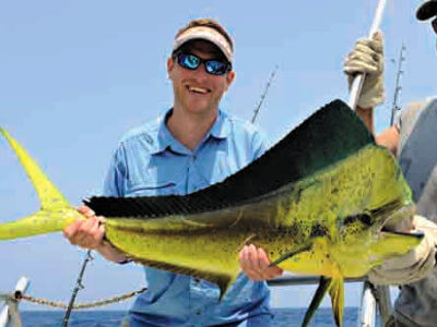Many Outer Banks visitors often join together to catch offshore species like mahi.